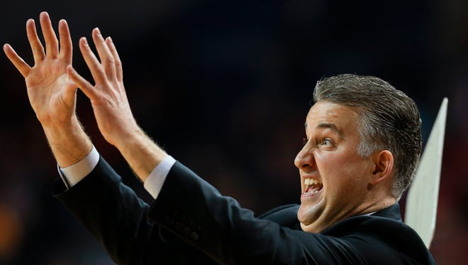 Purdue coach Matt Painter signals his players during the second half of Tuesday's 81-62 victory at Nebraska.