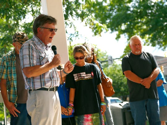Gary Lambert, pastor of Belmont Community Church, leads