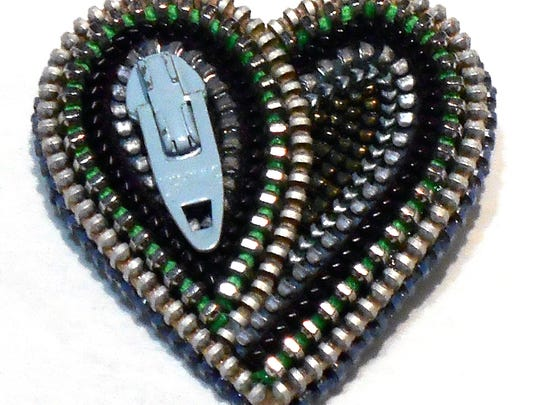 A zippered heart made by artist Stacie Mincher.