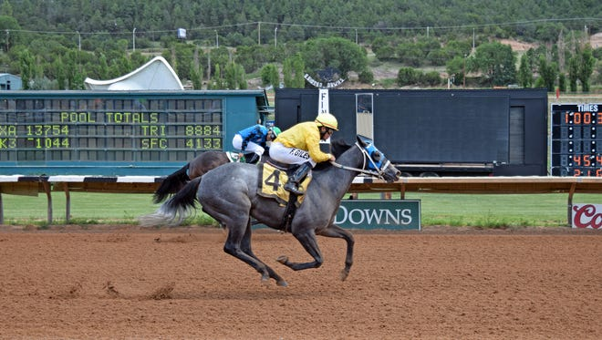 Sheza Snowball flew in the last one-eighth of a mile to get up and catch Vocally on the $30,000 Turquoise Stakes for New Mexico-bred two-year-old fillies at Ruidoso Downs on July 23.