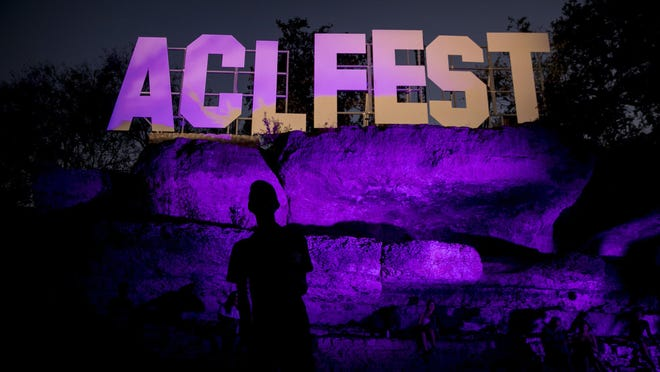 Ian Collier of Austin gets his photo made in front of the ACL Fest sign at the Austin City Limits Music Festival in Zilker Park on October 5, 2019.