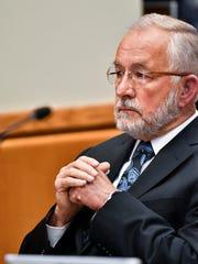 Former MSU dean William Strampel sits in 54B District