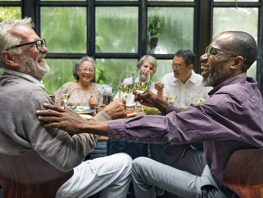 Mature friends at a dinner party