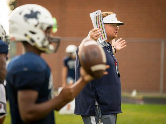Roosevelt High School head coach Erik Link talks to