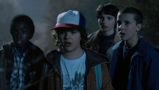 Millie Bobby Brown, Finn Wolfhard, Gaten Matarazzo and Caleb McLaughlin in 'Stranger Things'