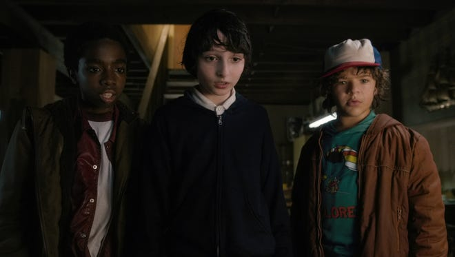 Lucas (Caleb McLaughlin, left), Mike (Finn Wolfhard) and Dustin (Gaten Matarazzo) uncover a larger, more sinister conspiracy in the first season of 'Stranger Things.'