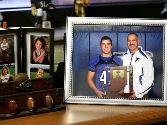 A copied photograph of North Vermillion High School football player Braeden Hollowell and his dad and athletic director Marty Brown.
