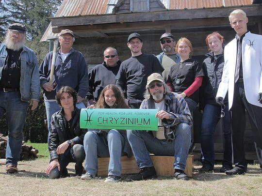 """The cast and crew of """"Chryzinium"""" stand in front of a set built in Stayton."""