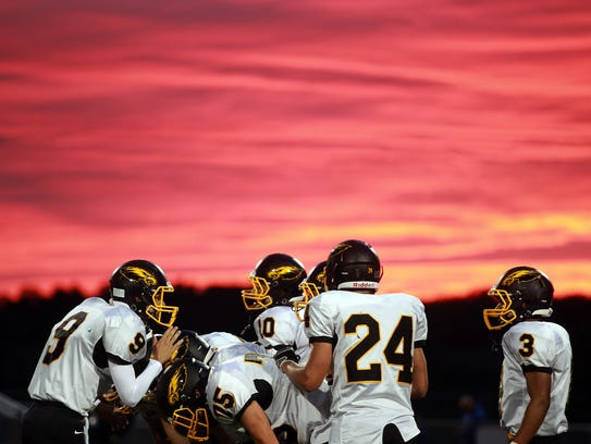 Mid-Prairie players huddle up during the Golden Hawks'