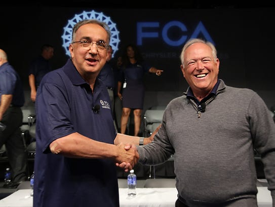 Fiat Chrysler CEO Sergio Marchionne, left, shakes hands