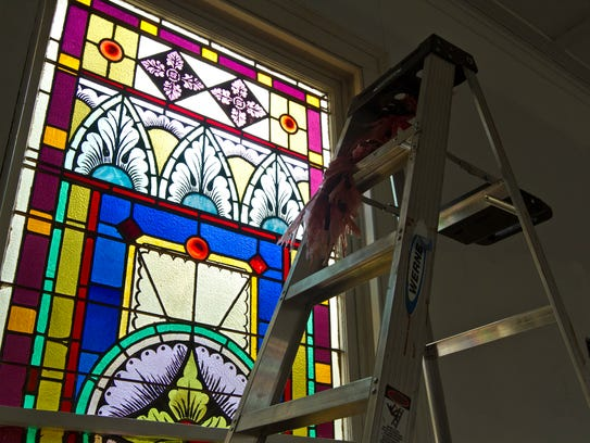 Original stained glass windows adorn the walls of the
