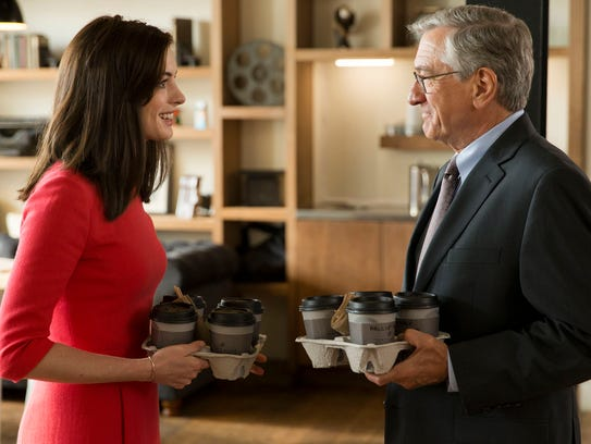 Anne Hathaway as Jules Ostin and Robert De Niro as