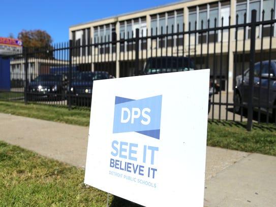 Signage for Detroit Public Schools sits outside of