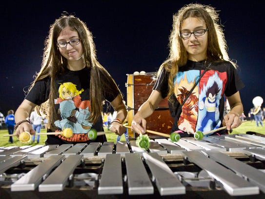 Anna Guinee and Hollyann Tobon play the vibraphone.