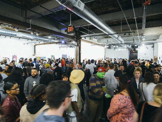 Attendees at the Red Bull House of Art in Detroit's