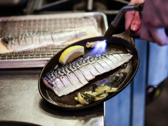 Torched mackerel is prepared during the Detroit Free