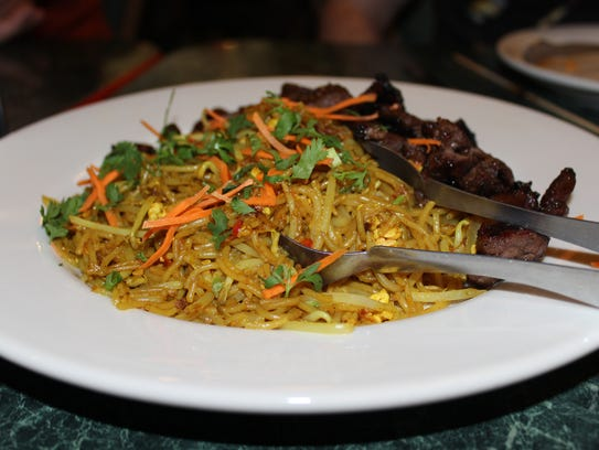 Bihun goring karri with grilled short ribs at Indo.