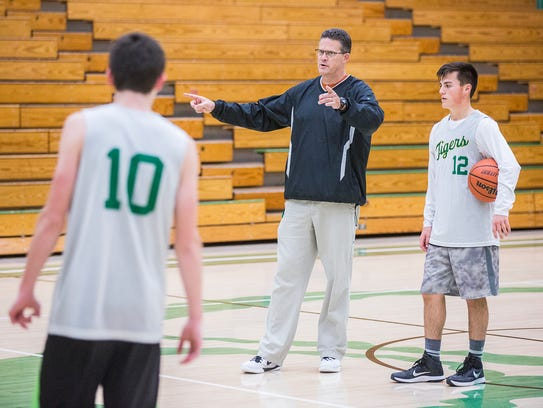 Yorktown basketball players run through drills during