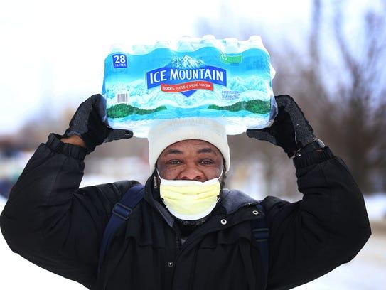 Carl Huntere, 48, of Flint, Mich., walks  home through