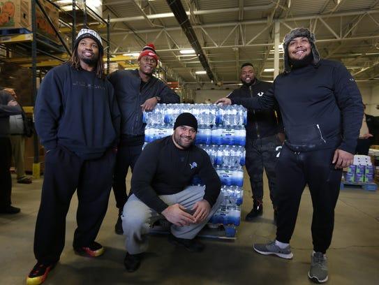 Detroit Lions (from left) Darryl Tapp, Ziggy Ansah,