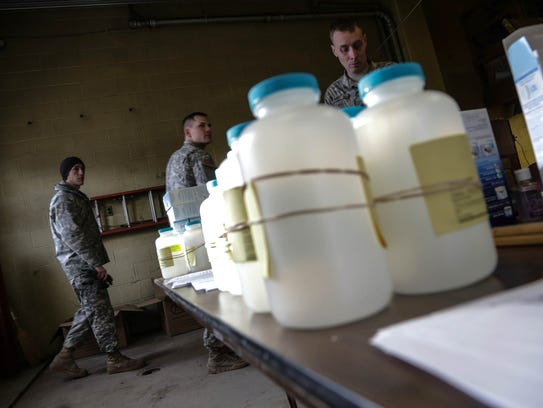 Water analysis test kits sit for Flint residents to