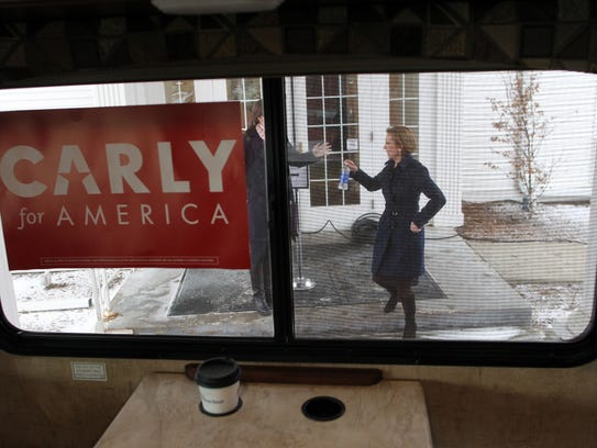 Carly Fiorina heads to her campaign bus after an interview