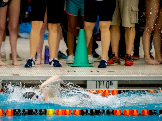 Dover's Maddi Hetrick swims to first place from lane