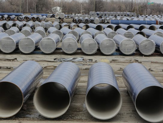 Sections of pipeline are seen in a lot along Stewart
