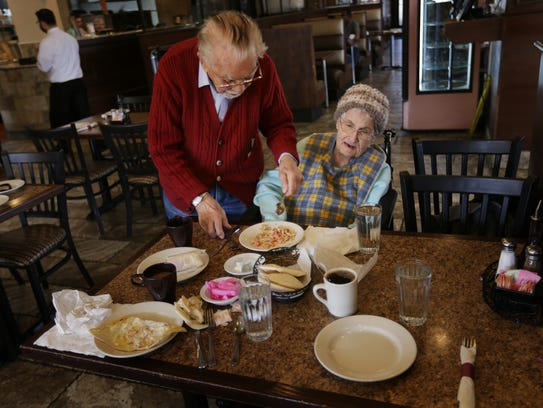 James Harvey, 93 cuts his wife's food Zelmira Harvey,