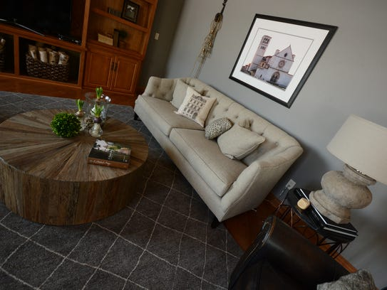 Personalized art and a reclaimed wood coffee table