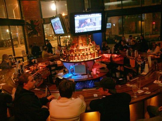 People enjoy the Tiger's baseball game at Park Bar,