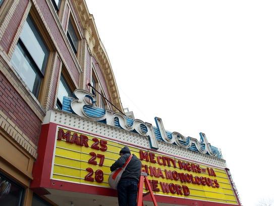 Alex Brandt updates the Englert Theatre marquee on