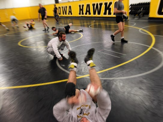 Former Hawkeye Daniel Dennis warms up during practice