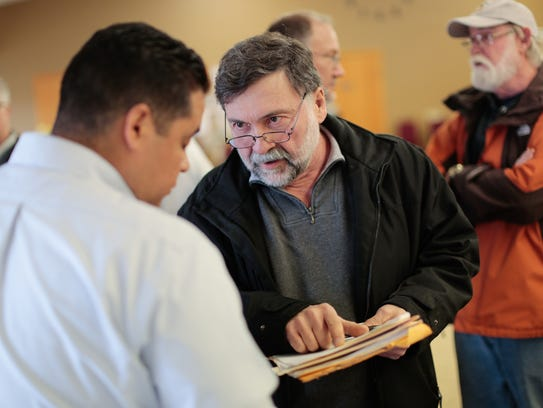 Wurtsmith Air Force Base veteran Roger Arvo questions