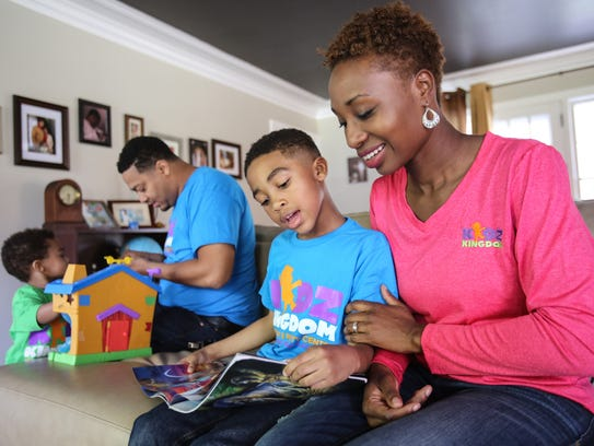 Danielle North, 33, reads a book with one of her sons,