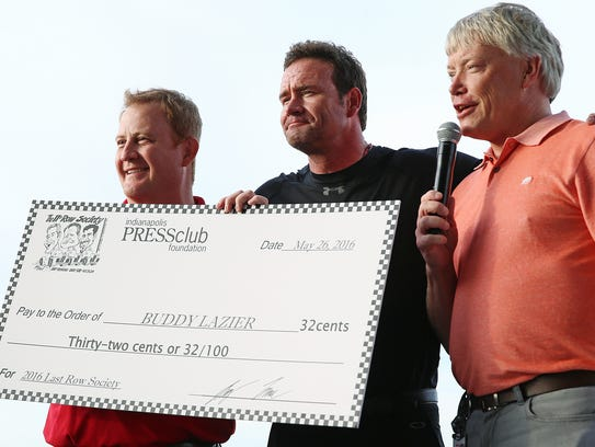 IndyCar driver Buddy Lazier receives a giant check