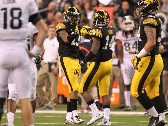 Iowa cornerbacks Greg Mabin (left) and Desmond King