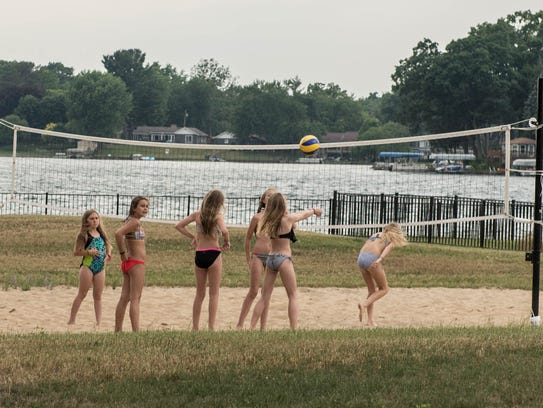 Kids play on the volleyball court at Willard Beach