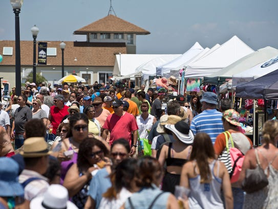 Bradley Beach lined with people and food vendors at
