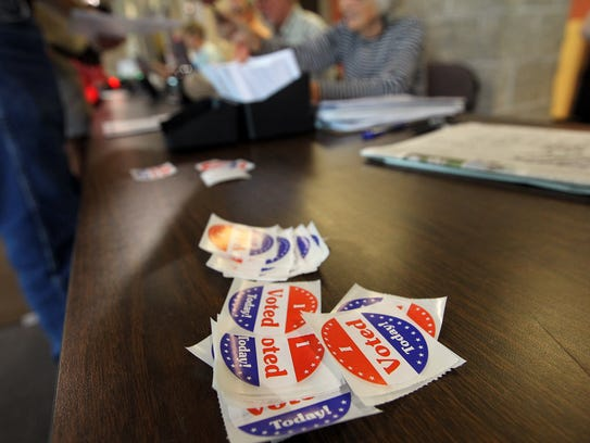 Voter stickers are distributed at West High on Tuesday,