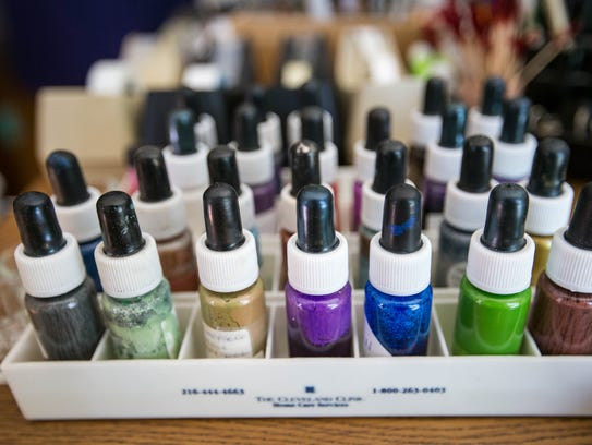 Bottles of mixed gouache paints sits on Vicki Corwin's