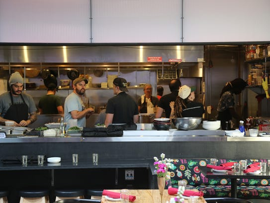 The kitchen is open to the windowless dining room at