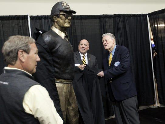 Former Iowa head coach Hayden Fry unveils his bronze