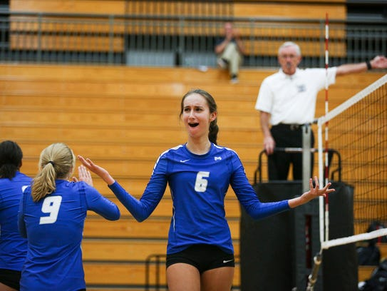 McNary's Valerie Diede holds out her hands as the referee
