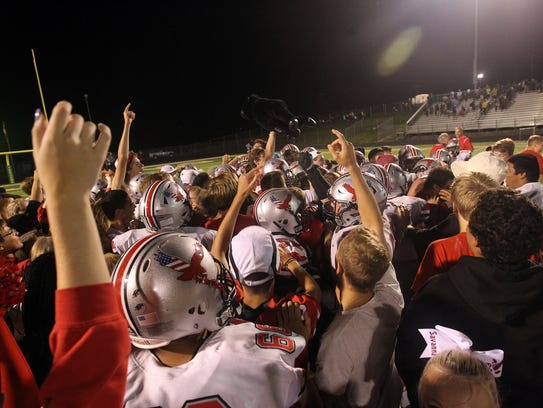 City High players and students celebrate their 20-7