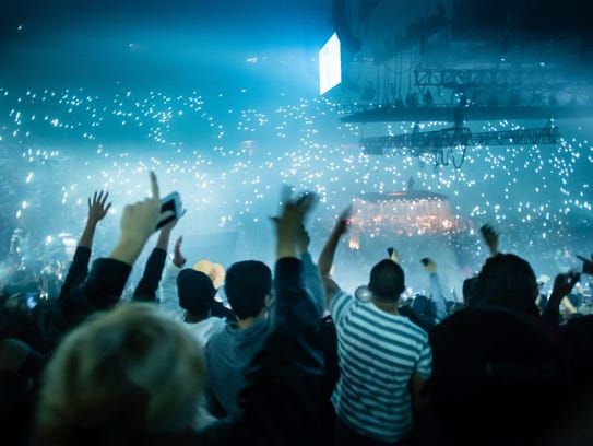 Rapper Kanye West sings to the crowd at Joe Louis Arena