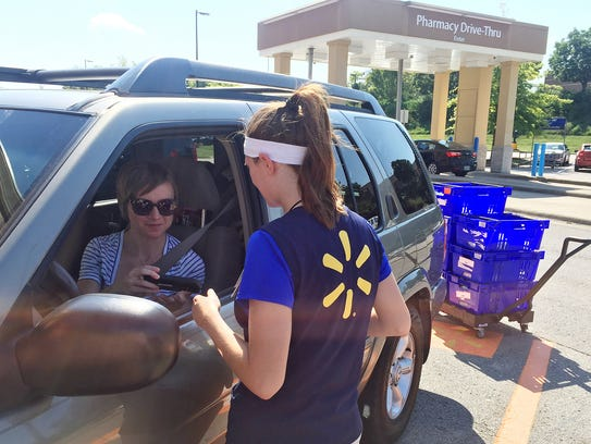 Ashley Green, 31, talks to a Wal-Mart personal shopper