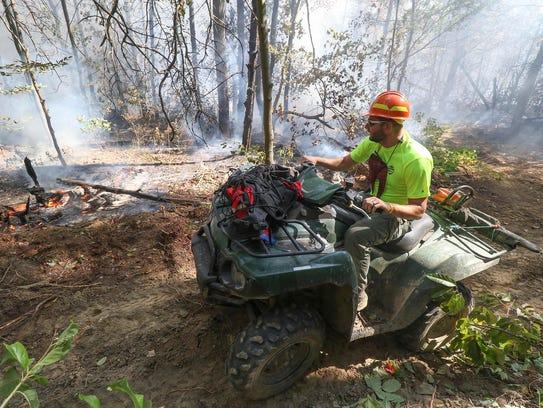 Cumberland Trail Ranger Anthony Jones monitors a wildfire