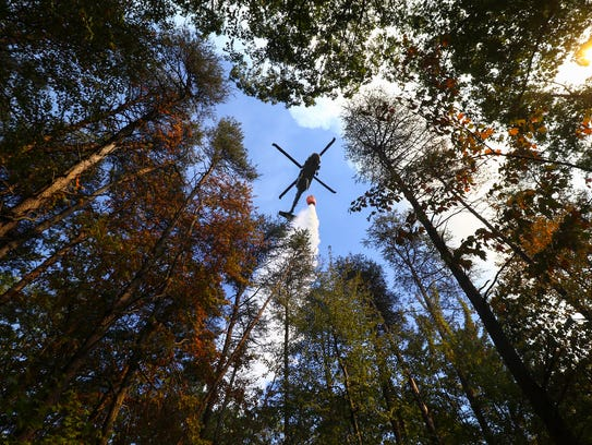 A Tennessee Air National Guard helicopter dumps water