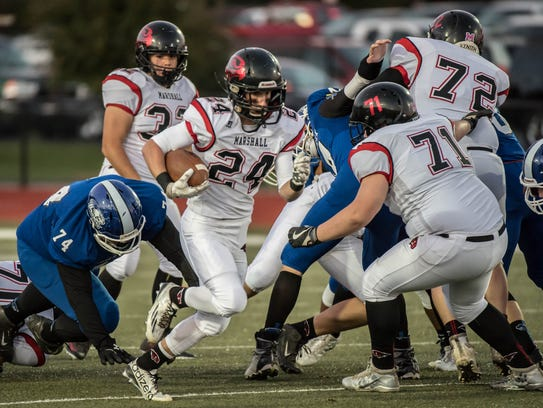Marshall's Brad Feasel (24) and the Redhawks are 4-4